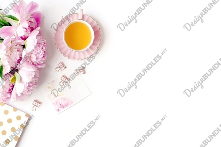 Flat lay scene with pink peonies