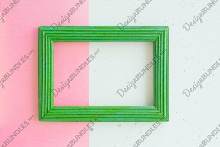 Wooden green photo frame on white and pink background example image 1