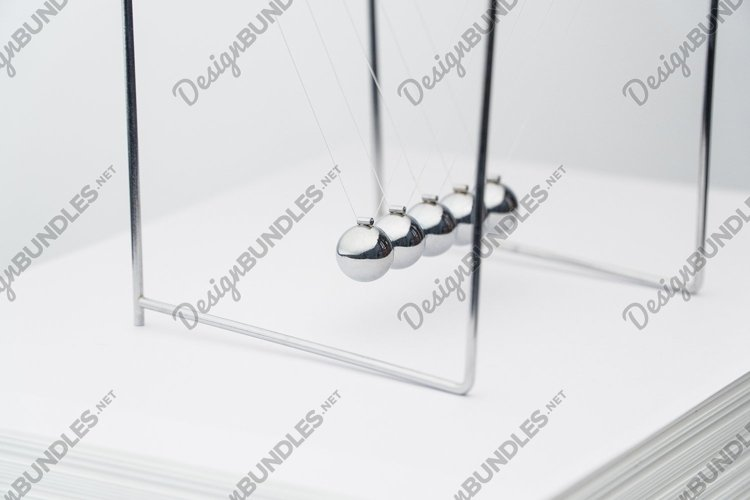 Pendulum on a white background example image 1