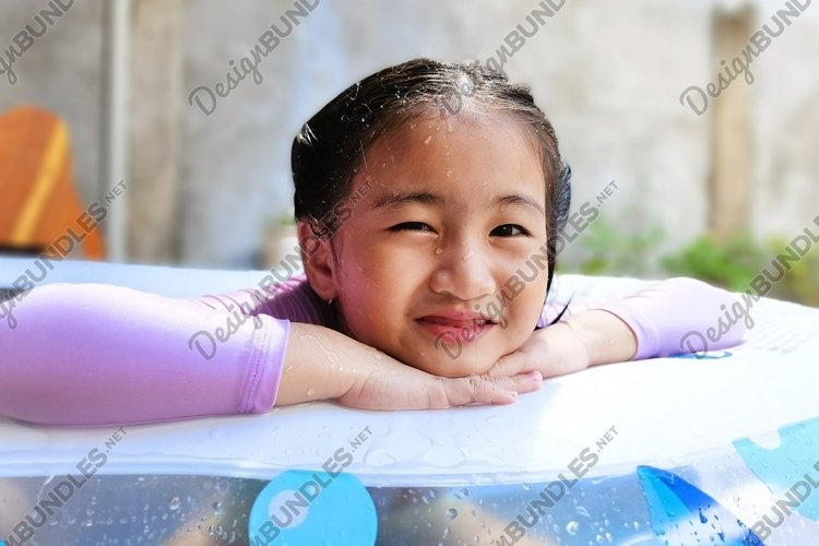 Girl at the Inflatable Pool example image 1