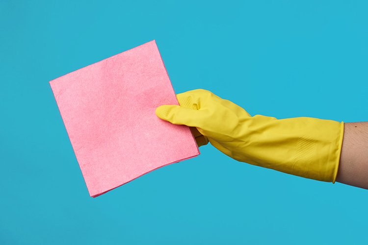 yellow rubber glove for cleaning dressed on a female hand example image 1