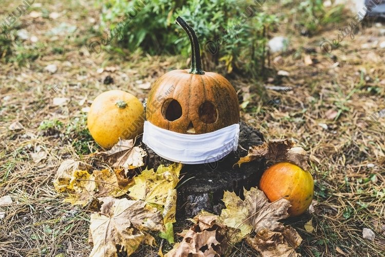 halloween pumpkin in protective mask, holiday concept virus example image 1