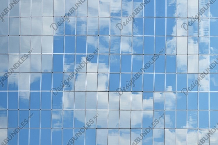 Cloudy Sky Reflection in Business Building Windows