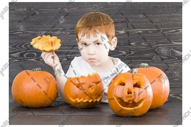 little boy is preparing a pumpkin example image 1