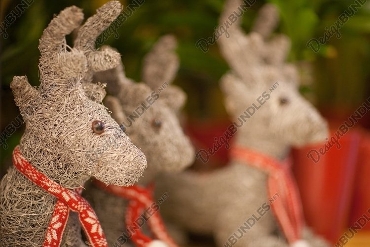 Toy Christmas reindeer with a red knitted scarf example image 1