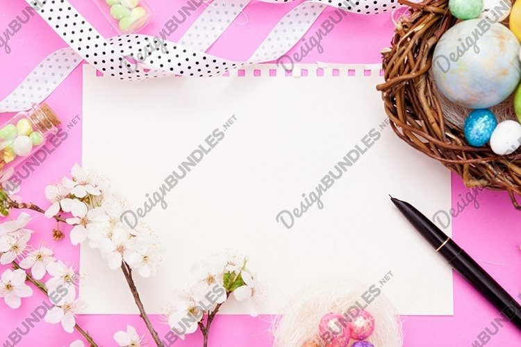 Nest with eggs and flowers flat lay blank sheet template example image 1