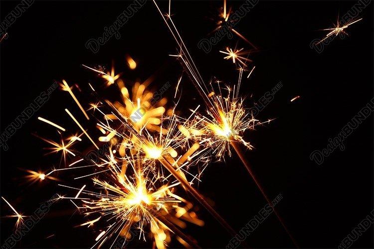 Close up Several Firework Sparklers over Bblack