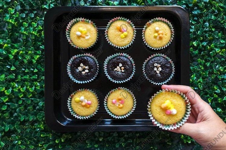 Hand Holding Cupcake I Stock Photo example image 1