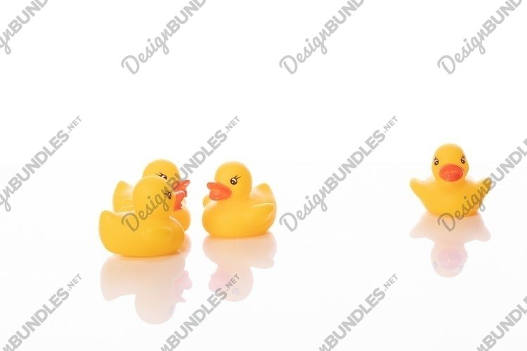 Mini yellow rubber duck isolated on white background. example image 1