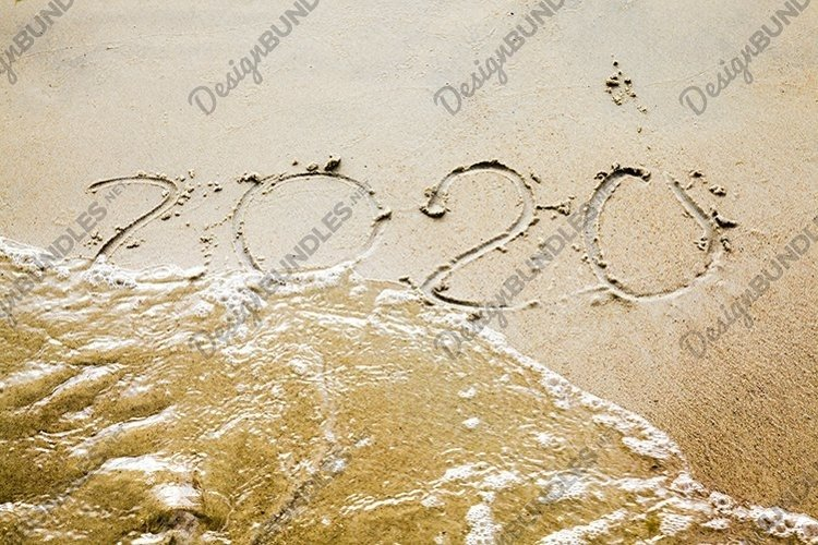 sea waves erasing the inscription of 2020 example image 1