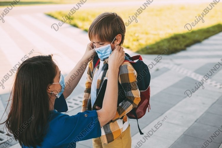 Mom with a child in a mask go to school or kindergarten. example image 1