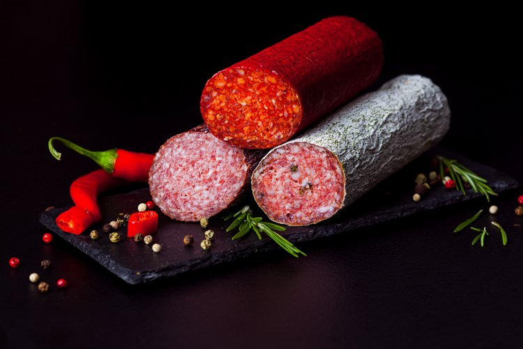 The wide selection of smoked sausages sprinkled with spices example image 1
