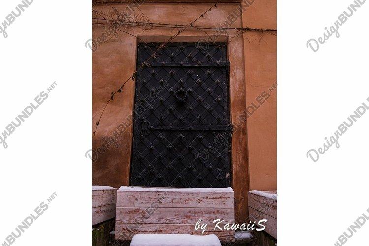 Vintage black metal door Antique building exterior detail example image 1