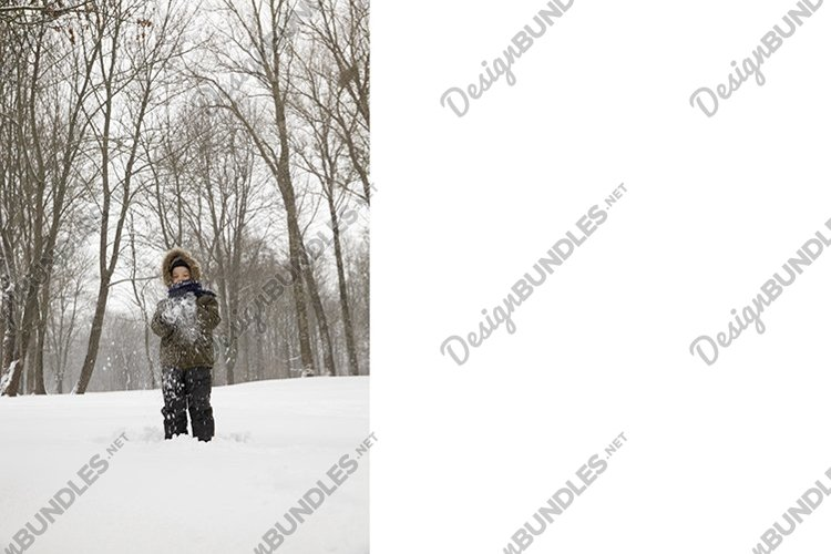 boy plays with snow example image 1