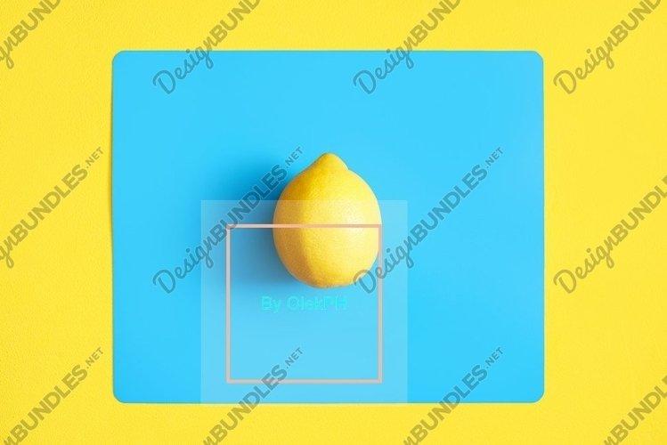 Lemon on a blue background. creative design concept example image 1