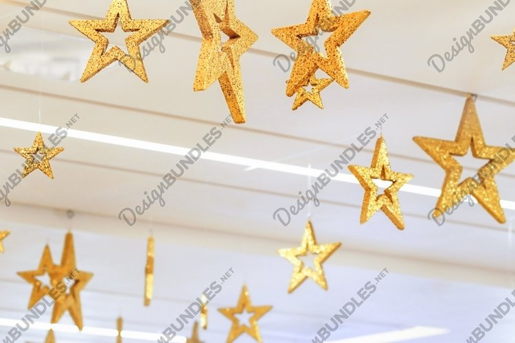 Blurred Gold stars decoration of the ceiling in the mall example image 1
