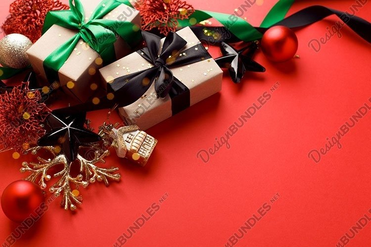 Christmas gifts, presents, ornaments on red table example image 1