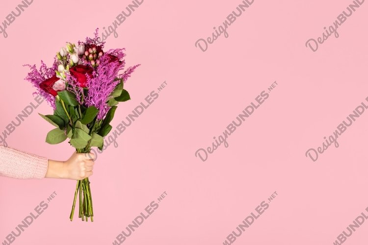 Female hand hold beautiful bouquet of flowers isolated