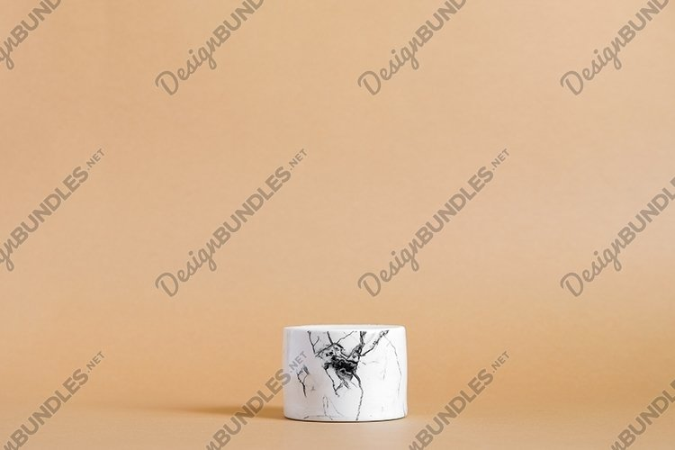 Empty white marble podium on pastel beige color background example image 1