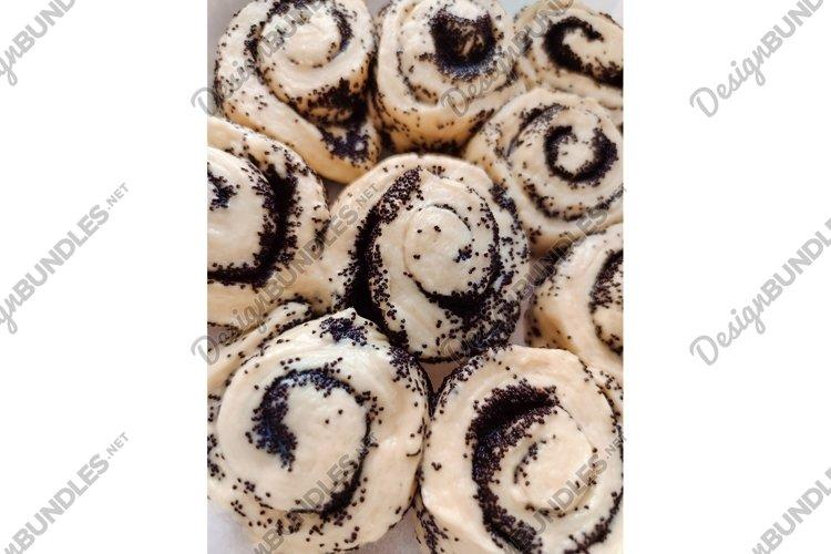 Cinnamon bun poppy seeds raisins cream glaze bakery photo example image 1