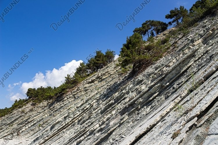 Picturesque stone wild beach at the foot of the rocks. 3pcs example image 1