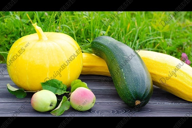 Ripe vegetables on a wooden table. Harvest time. example image 1