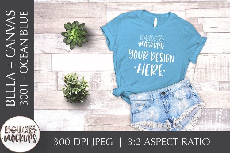 Bella Canvas 3001 Woman's T Shirt Mockup, Ocean Blue Flatlay example image 1