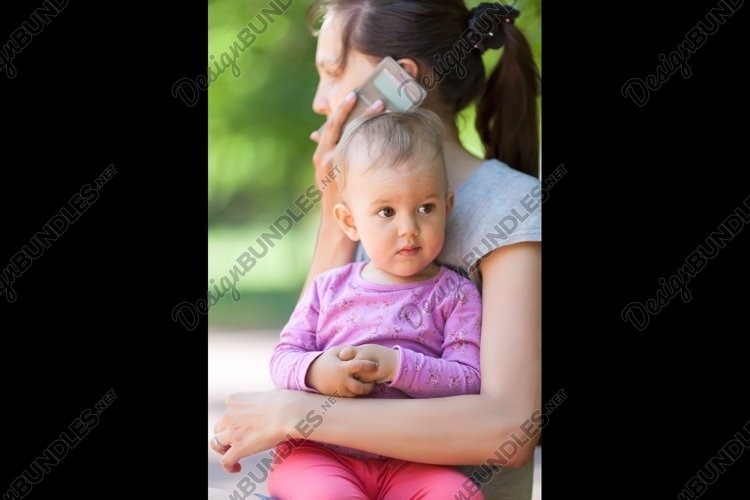 Baby girl in mothers arms example image 1