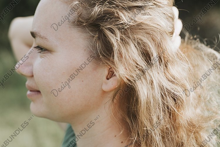 small intra channel hearing aid in the ear of a woman example image 1