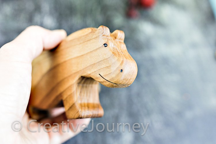 Wooden toys close up. Hippo.