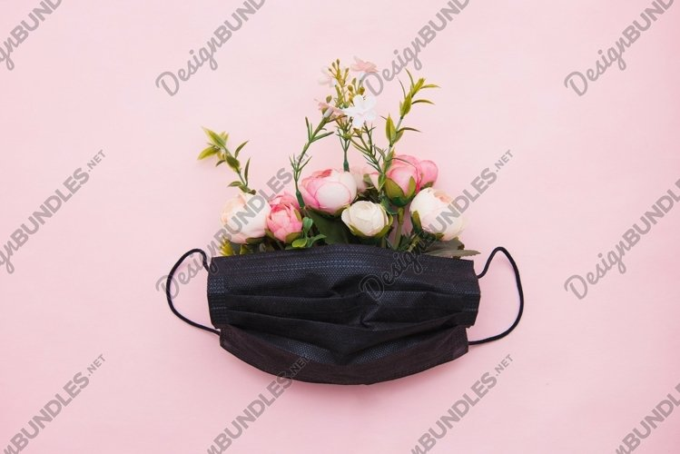 Medical face mask with flowers on pink background example image 1