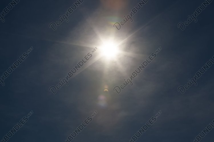 the sun shining in the sky example image 1