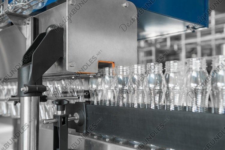 Empty plastic bottles on conveyor belt. Dairy plant example image 1