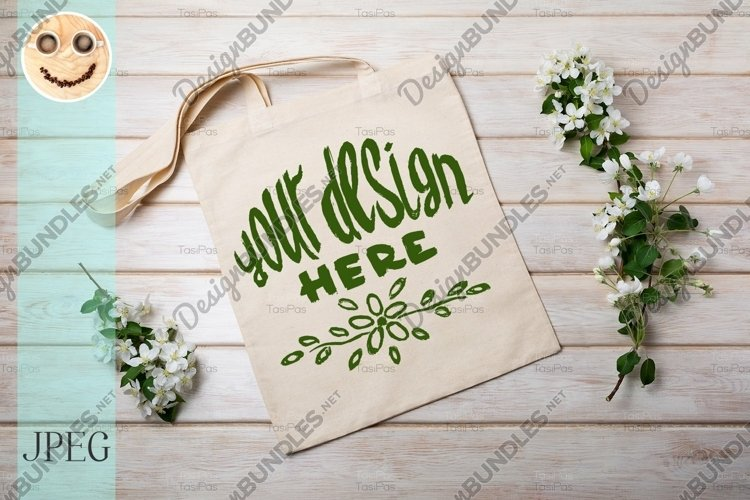 Rustic tote bag mockup with blooming apple tree branch