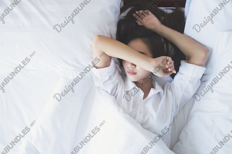 Woman sleeping in bed. example image 1