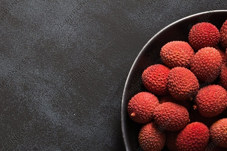 Fresh organic Lychee fruit in black plate. example image 1
