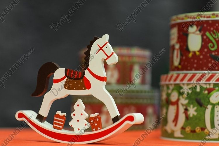 Little toy horse with a gift box. Christmas decorations example image 1