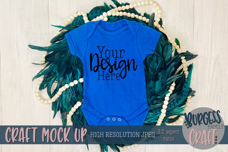 Royal blue peacock baby bodysuit Craft mock up