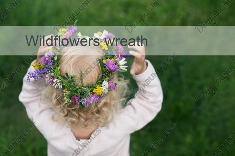 Girl with blond curly hair wearing colorful flower wreath