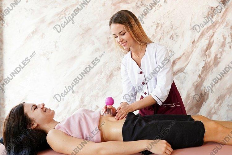 Professional masseur doing massage in the salon