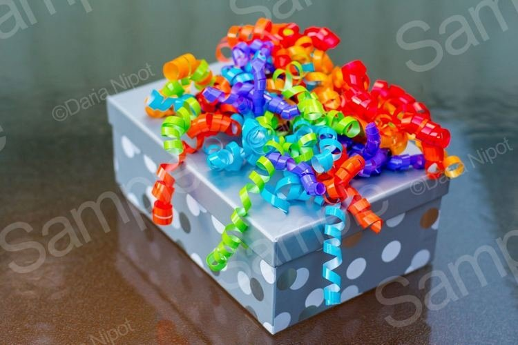 Gift box with a colourful spiral curly ribbon