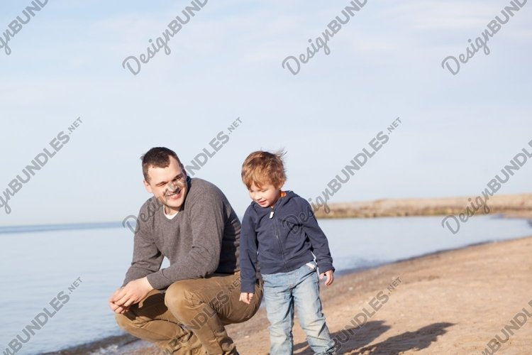 Father with his young son at the beach example image 1