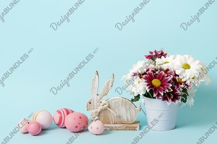 easter blue card with flowers, bunny and pink eggs