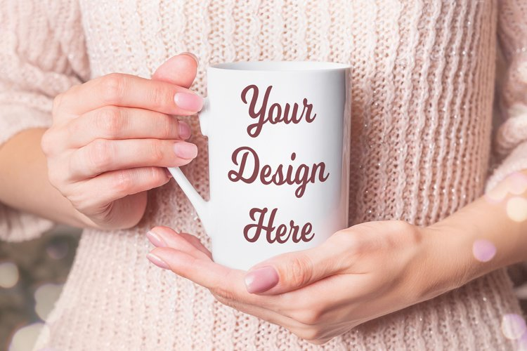 Mockup - White cup in the hands of woman in a winter sweater example image 1