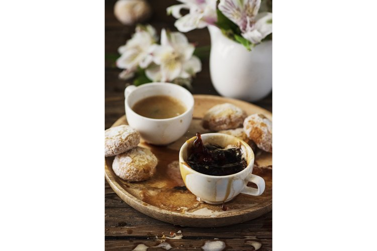 A cup of a strong Italian coffee on the wooden table example image 1