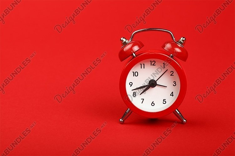 Small Alarm Clock over Red Backgound example image 1