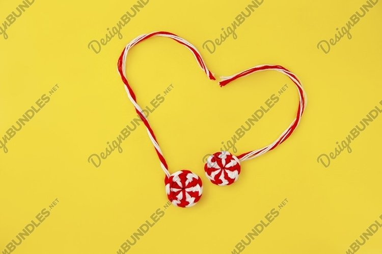 knitted red white candy caramel heart on yellow background example image 1