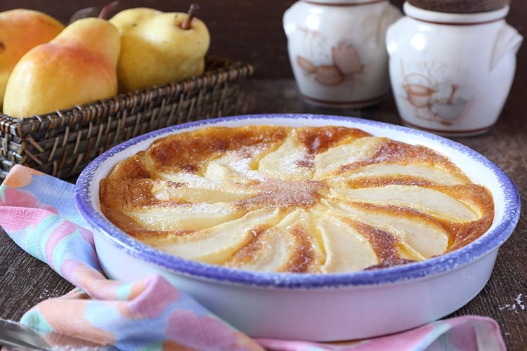 French cuisine. Pear clafoutis and yellow pears