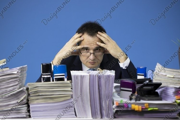 overworked Businessman employee sitting at table example image 1