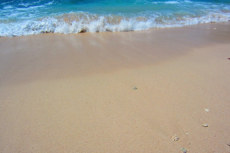 waves and white sand